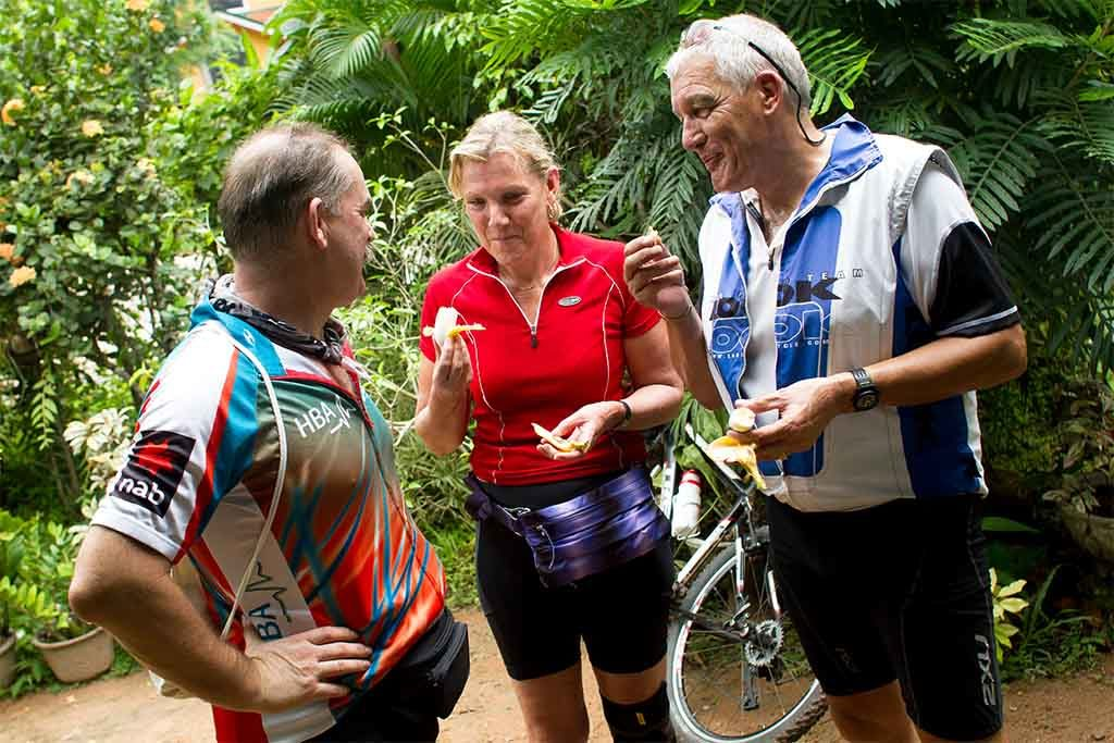 Cyclists hanging out eating banana in Sri Lanka