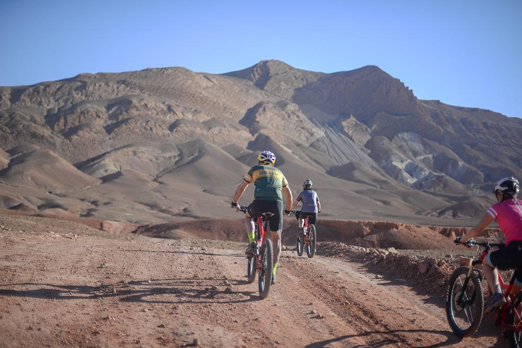 Cyclists riding in Morocco mountains on an off-road track
