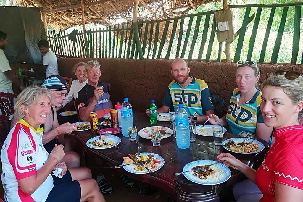 Cyclist enjoy local food in Sri Lanka